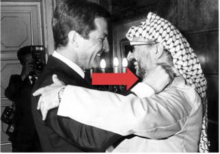 El expresidente con el líder palestino Yasser Arafat