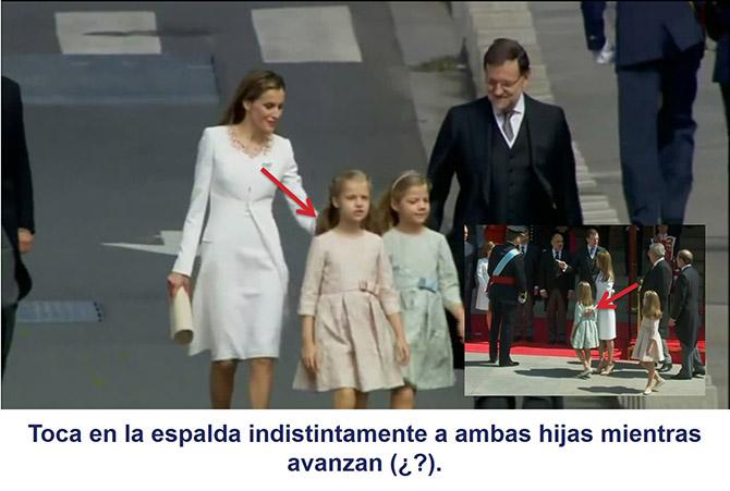 La reina Letizia toca instintivamente a ambas hijas mientras avanzan